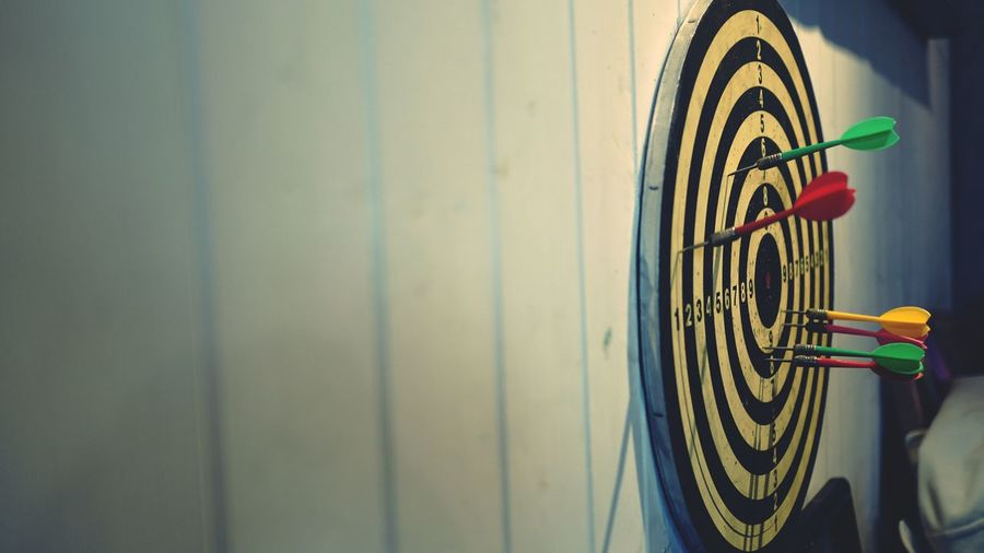 Close-up of darts on sports target