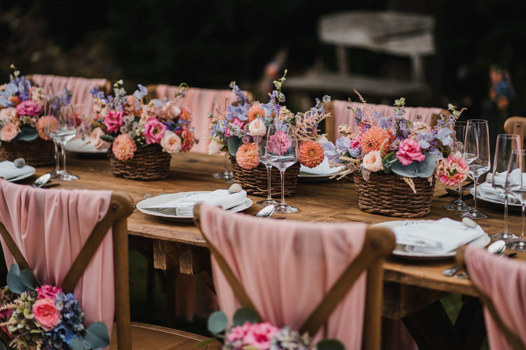 Wedding table decoration and seating with flowers and roses and plate