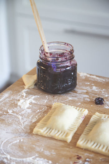 Close-up of preserves in jar by ravioli on table