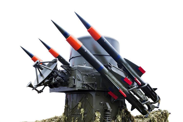 Toy rocket against white background