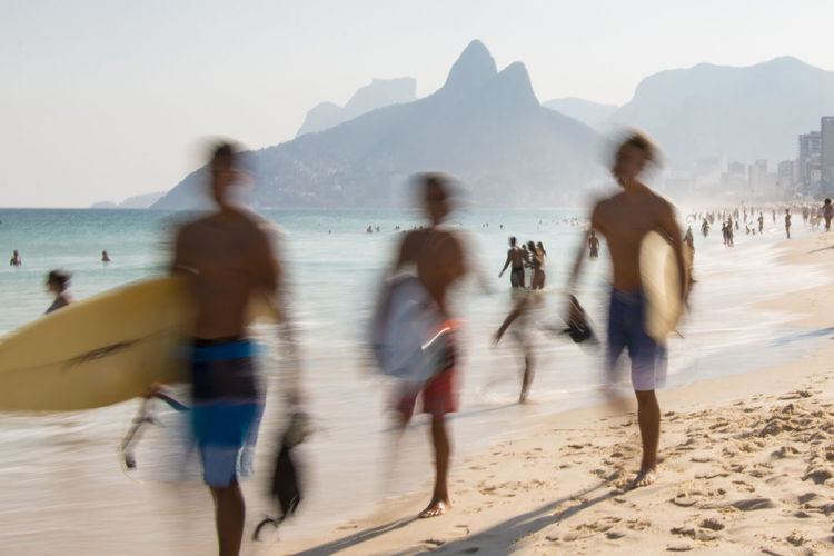 À la plage | Ipanema Beach capturing motion Beach Clear Sky Leisure Activity Mountain Mountain Range Outdoors Relax Sea Sunny Day Unrecognizable Person Vacations Water The Great Outdoors - 2017 EyeEm Awards The Street Photographer - 2017 EyeEm Awards