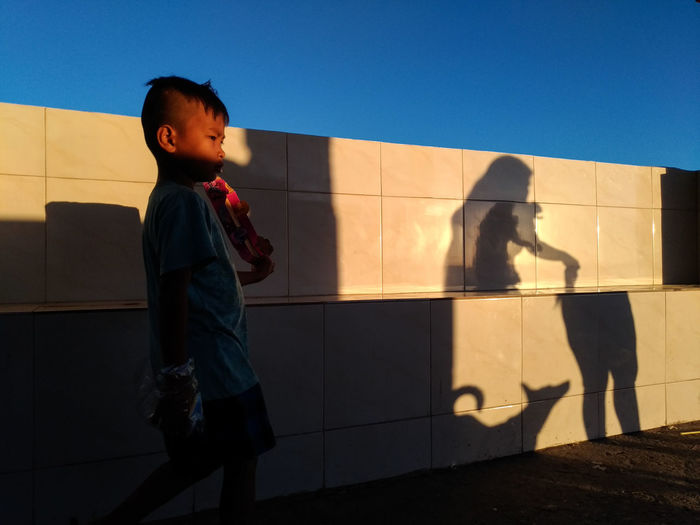 street photography EyeEm Best Shots The Street Photography EyeEm Best Shots Light And Shadow Color Street Child Childhood Shadow Standing Boys Sky The Street Photographer - 2018 EyeEm Awards