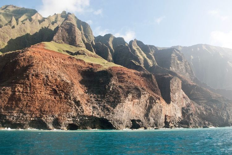 Hawaii Life Hawaii Napali Coast Mountain Water Sky Beauty In Nature Nature Sea Scenics - Nature Rock - Object Sunlight Environment Tranquil Scene Formation Waterfront No People Rock Scenery Outdoors Mountain Range Day Mountain Peak