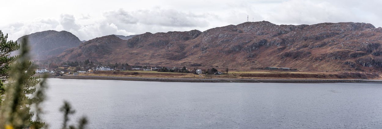 Scotland 💕 Beauty In Nature Day Fresh Water Loch Landscape Mountain Mountain Range Nature No People Outdoors Photo Merge Photography Physical Geography Poolewe Loch Ewe Scenics Sky Tourist Destination Tranquil Scene Tranquility Tree Water Shore Non-urban Scene Idyllic Remote Horizon Over Water Countryside Rugged Natural Landmark Geology Panoramic