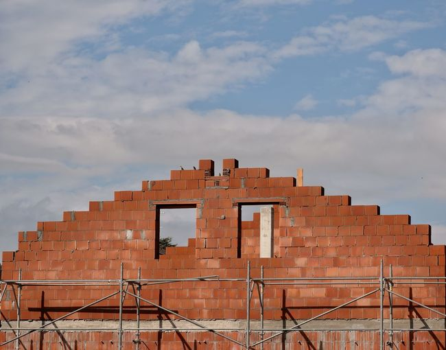 A red brick house under construction