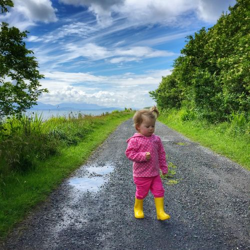 Toddler in wellies walking Childhood Child Sky Full Length Cloud - Sky One Person Day Baby The Way Forward Field Grass Real People Tree Road Outdoors Growth Nature People