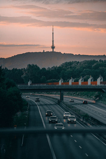 German autobahn a2 at sunset with cars and the bielefeld television tower in the background