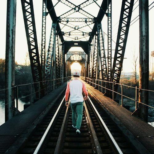 Rear view of man on bridge