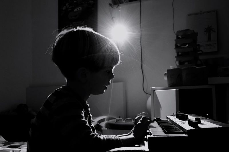 Boy making music Making Music Playing Instrument Canon Eos 200d Morten Müller-Schnelle Korg MicroKorg XL KORG Synthesizer Music One Person Real People Arts Culture And Entertainment Musical Instrument Indoors  Child Musical Equipment Playing