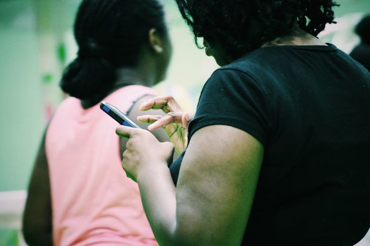 Woman text messaging using mobile phone