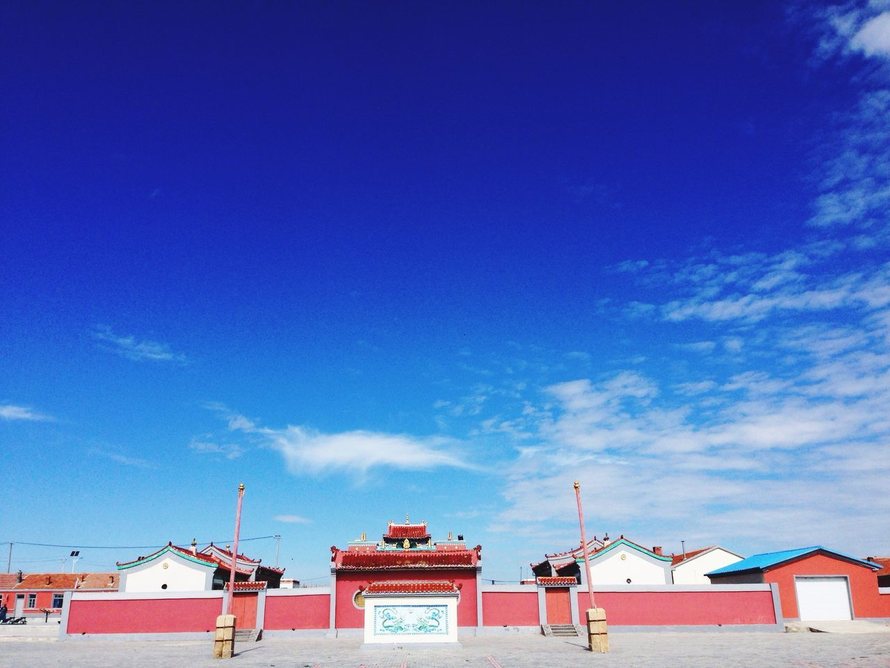 architecture, built structure, blue, building exterior, sky, outdoors, red, day, no people, cloud - sky, low angle view, nature
