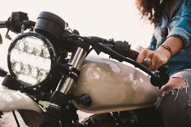 Midsection of woman riding motorcycle