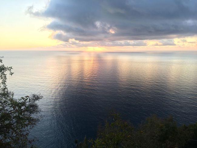 Sky Water Tranquility Sunset Beauty In Nature Scenics - Nature Tranquil Scene Idyllic Land Horizon Over Water No People Beach Horizon Nature Orange Color Sea Reflection Sunlight Sun Cloud - Sky