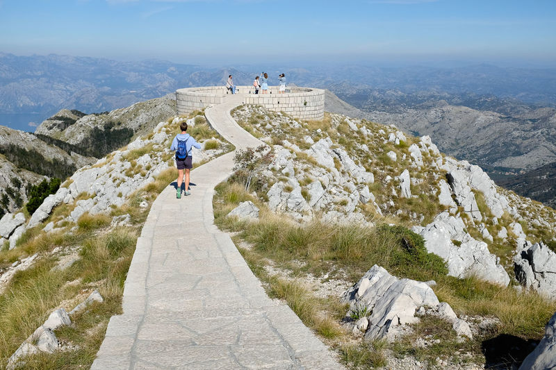 Njegos Mausoleum - tourist attraction in Lovcen, Montenegro Hiking Steps Tourist Attraction  Walking Around Adventure Architecture Cliff Day Full Length High Angle View Leisure Activity Montenegro Mountain Njegos Mausoleum Outdoors Pattern Paved Path Rear View Scenics Tourism Travel Destinations Walking