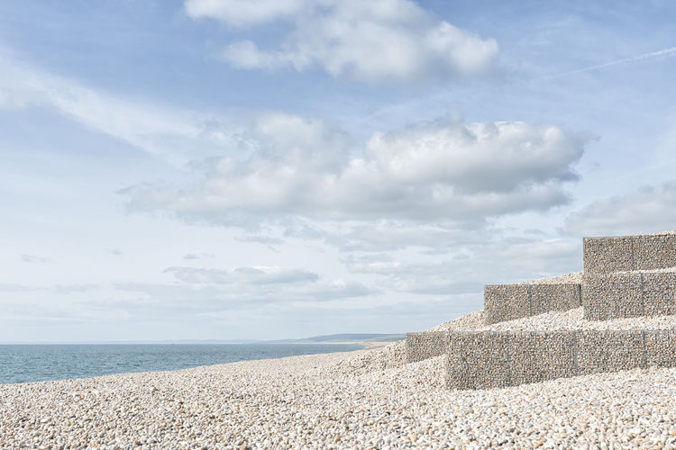 Gabion Baskets Gabion Boxes Gabion Basket Nature Beach Sea Pebble Beach Landscape Backgrounds Travel Vacations Holiday Summer Sunny Chesil Beach Scenery Jurassic Coast Outdoors Tranquility No People Beauty In Nature Sky Water Tourism Relaxing