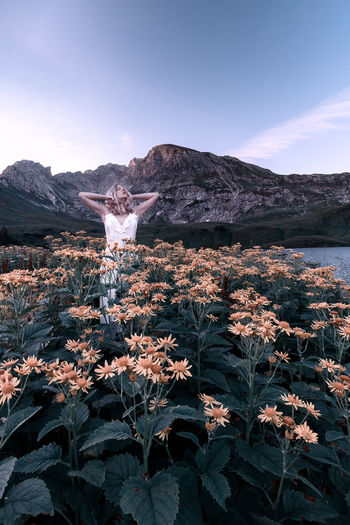 Selfportrait at sunrise Dress Nature Female Art Blonde Girl Mountain Range 10-18mm Canon EOS 750D Canonphotography The Great Outdoors - 2018 EyeEm Awards Fine Art Photography The Creative - 2018 EyeEm Awards Schrecksee Sunrise Yellow Flower Vintage Fashion Mood Water Sea Sky Blooming Scenics Mountain Tranquil Scene Idyllic Tranquility