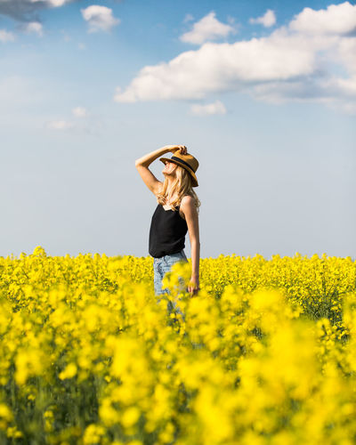 Paint The Town Yellow Flower Sky One Person Only Women Rural Scene Agriculture One Woman Only Yellow Nature Oilseed Rape Day Cloud - Sky Field Adult Sun Hat Summer Adults Only Outdoors Leisure Activity People