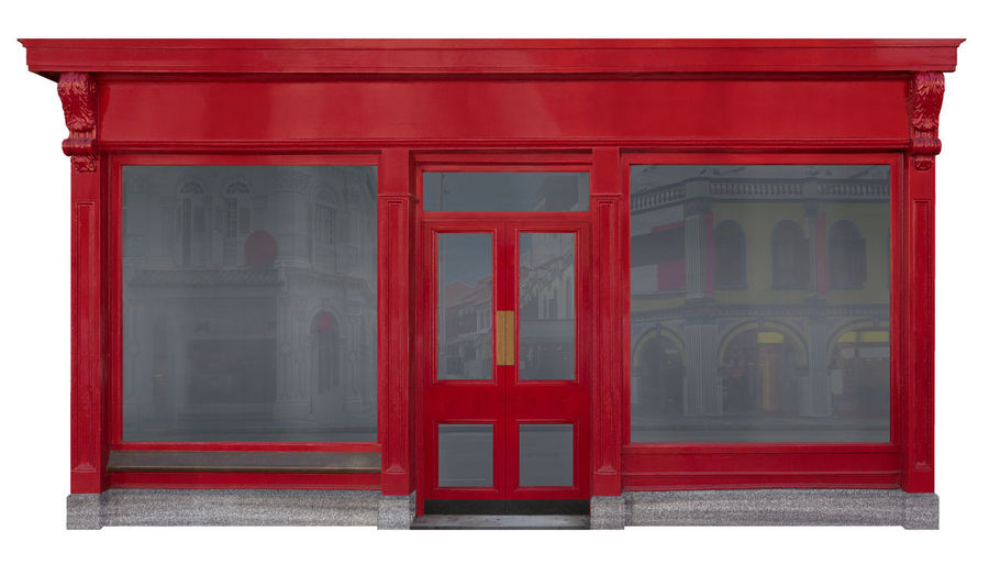 Storefront facade with red front view in shop windows and a door in the middle isolated on white background 3d Rendering Entrance From The Front Right To The Back, The Place To Be On Good Friday Is At HOME Main Entrance Office Red Reflection Sale Wooden Facade Architecture Building Exterior Business Finance And Industry Empty Showcase Entrance With Wood For Rent Front View Load Office Space Reopening Salesroom Showroom Store Window Storefront Trade Trader