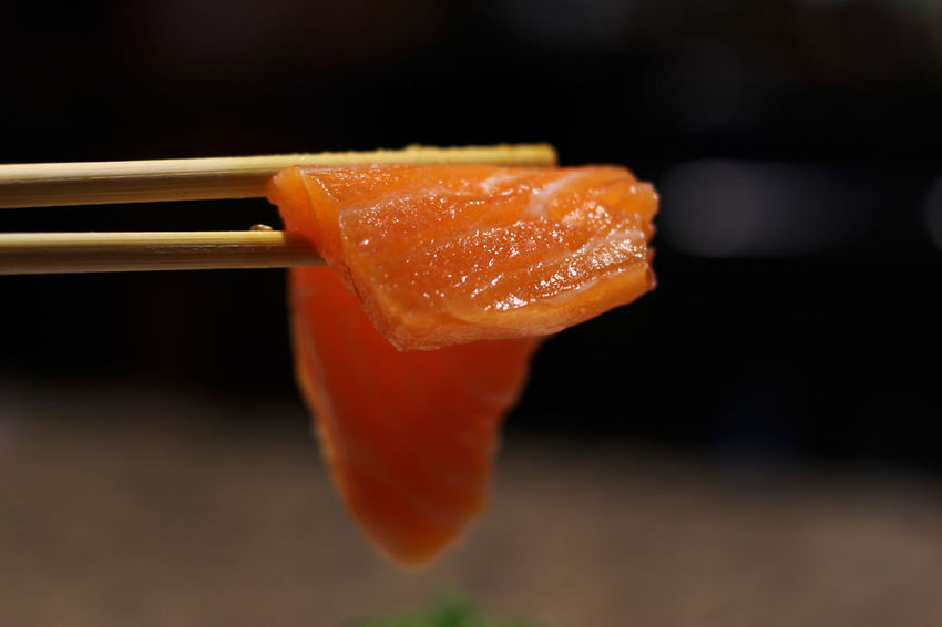 Japanese Food Raw Sushi Chopsticks Close-up Day Fish Food Food And Drink Freshness Healthy Eating Indoors  No People Raw Food Ready-to-eat Red Salmon Sashimi  Shopsticks
