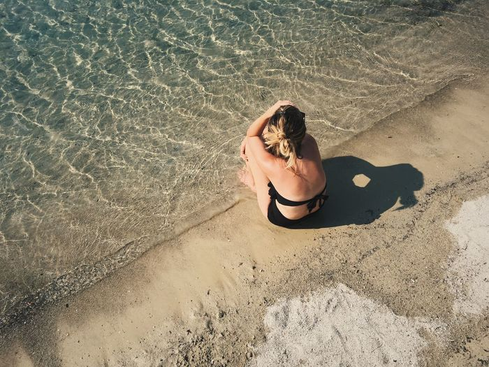 Sand High Angle View Beach One Person Leisure Activity Rear View Vacations Only Women Lifestyles One Woman Only Day Bikini Relaxation Adults Only Women Young Adult Outdoors Sunlight Real People Young Women The Week On EyeEm