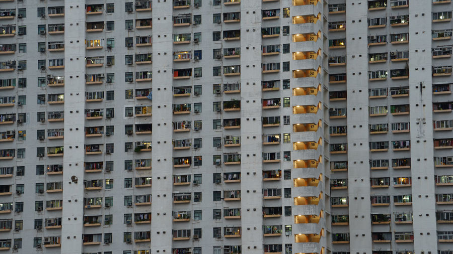 Hong Kong residential building Apartment Architecture Backgrounds Balcony Building Building Exterior Built Structure City City Life Day Everything In Its Place Full Frame HongKong In A Row Low Angle View Modern Night No People Outdoors Repetition Residential Building Residential Structure Window