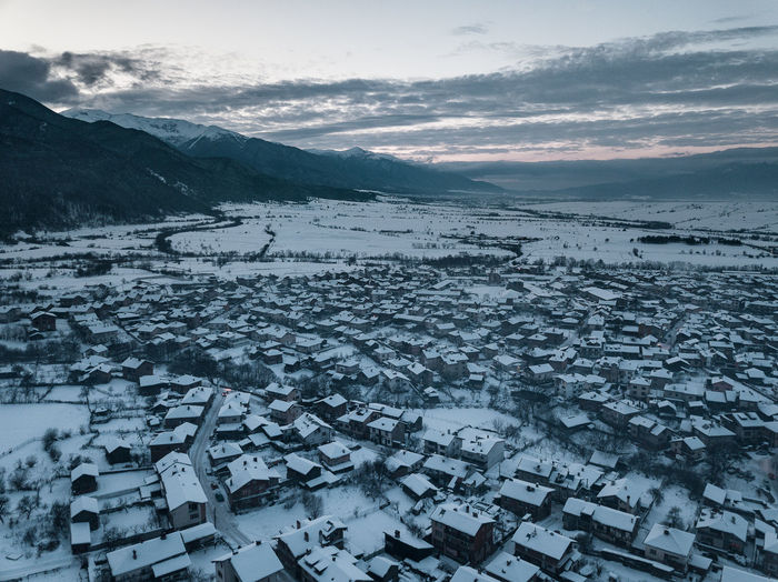 High angle view of snow covered cityscape