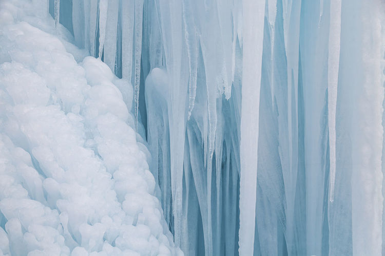 Full frame shot of icicles covered with snow