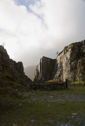 Rock Formation Mountain Sky Grass Cloud - Sky Overcast Physical Geography Rugged Cliff Rock - Object