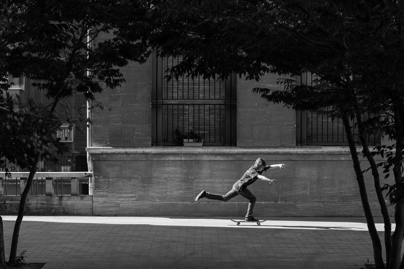 """"""" In constant search of light to push """" Outdoors Blackandwhite Bnw Cityscapes Getting Inspired Shootermag Eye4photography  EyeEm Best Shots Tree City Life People And Places Skateboarding Light And Shadow"""