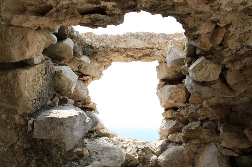 Ancient Ancient Civilization Arch Architecture Beauty In Nature Built Structure Cave History Monolithos Natural Arch Nature No People Old Ruin Rhodes Rock - Object Rock Formation Ródos