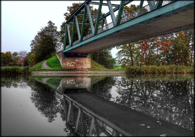 Mittellandkanal water reflections Water Reflection Bridge - Man Made Structure Day Tree Outdoors Architecture Nature Sky Red Color Rot Colors Kunst Ist Was Du Daraus Machst EyeEmNewHere Patrickhübner Hille Effects & Filters EyeEm Beauty In Nature Nature Red Water Reflections Green Color Landscape Spaziergang