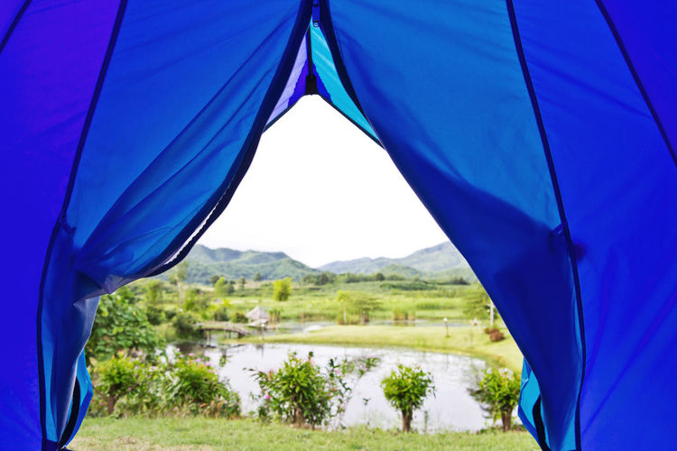Close-up of tent against blue sky