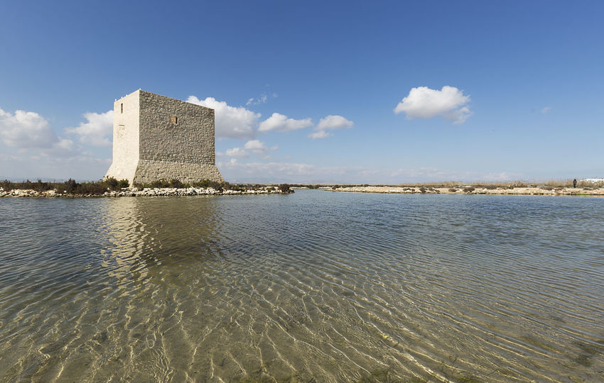 Tower of Tamarit in Santa Pola, province of Alicante, Spain. Alicante Coastline SPAIN Salinas Santa Pola Spanish Tamarit Architecture Building Exterior Built Structure Cloud - Sky Day Europe History Landmark Landscape Natural Park Nature No People Outdoors Pyramid Sea Sky Tower Water