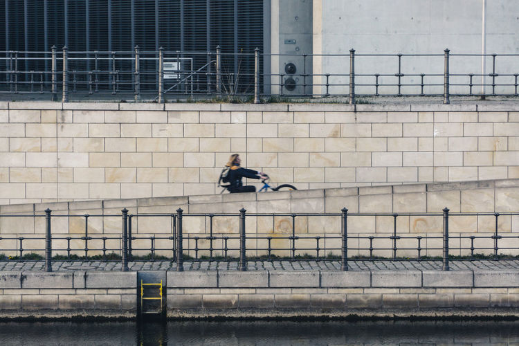 Man riding bicycle on wall