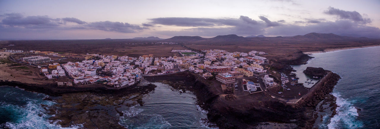 fuerteventura canarian islands spain drone aerial corralejo panorama sunrise DJI Mavic Pro Fuerteventura Wanderlust Aboutpassion Aerial View Architecture Building Building Exterior Built Structure City Cityscape Cloud - Sky Dronephotography High Angle View Mountain Nature No People Outdoors Residential District River Sky Travel Travel Destinations Vanlife Water