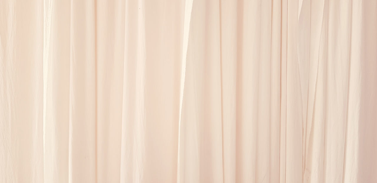 FULL FRAME SHOT OF CURTAIN HANGING FROM GLASS