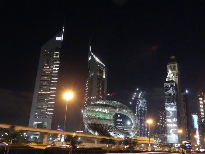 Buildings at Night on Sheik Zayed Road, Dubai, United Arab Emirates 2019 Dubai UAE 2019 Sheik Zayed Road Illuminated City Night Tall - High Museum Towers Tower Blocks Modern City Life Road Cityscape No People Modern Architecture Modern Design Office Buildings Black Background Low Angle View Composition Outdoor Photography Night Photography Travel Destinations