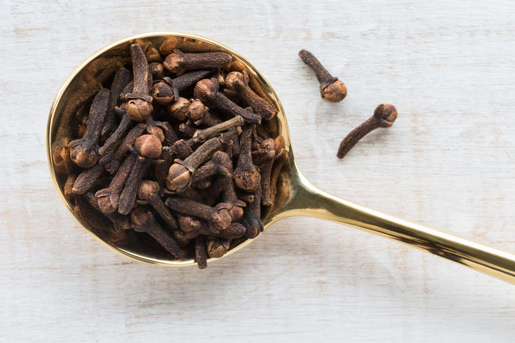 whole cloves Gold Golden Isolated Spoon Close-up Cloves Food High Angle View Ingredient No People Seasoning Spice