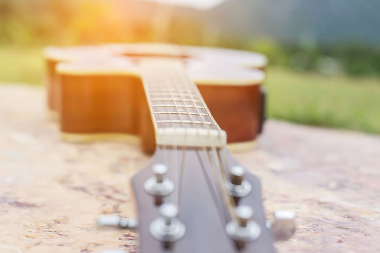Arts Culture And Entertainment Close-up Day Focus On Foreground Guitar Music Musical Equipment Musical Instrument Musical Instrument String Nature No People Outdoors Selective Focus String String Instrument