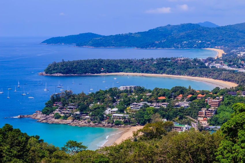 Beautiful seascape of turquoise ocean waves with boats, coastline and blue sky background from high aerial view point of Kata and Karon beaches in Phuket Thailand. Aerial View Of Beach Coastline Coastline Landscape Karon Beach, Phuket Karon Beach, Phuket, Thailand Kata Beach Kata Beach,Phuket Thailand Kata Beach Phuket, Thai Seascape Photography Aerial View Aerial View Of City Coastal Coastal Landscape Coastline Beauty Coastline Sky Karon Beach Karon View Point Karon Viewpoint Kata Kata Noi Beach Seascape Seascape Skyscape Turquoise Turquoise Sea