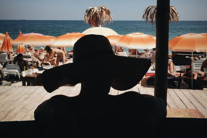 Beach Life Beach Photography Beachphotography Casual Clothing Hat In Front Of Leisure Activity Lifestyles Looking Men Person Rear View Sea Silhouette Smile Standing Tina Rips Tinarips Water Woman Hat Woman In Hat Woman In Hat Shadow Woman Sillouette Wooman Wooman Portrait
