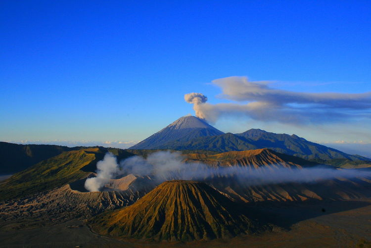 Mount Bromo Mountain Ash Erupting Volcanic Landscape Volcanic Crater Volcano Cone Sky Landscape Bromo-tengger-semeru National Park Smoke - Physical Structure Gas East Java Province Java Volcanic Activity