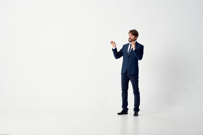 Full length of man standing against white background