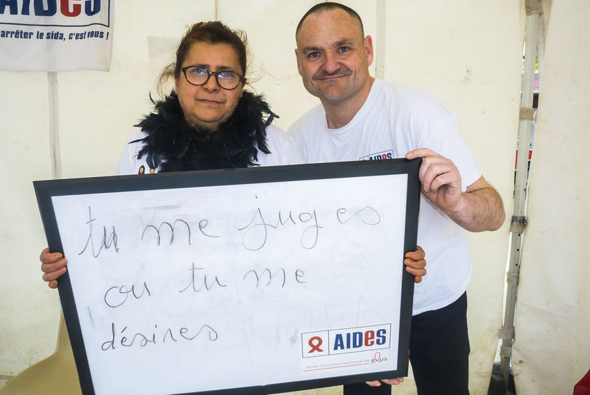 Paris, France, Portrait French People Holding Signs with Anti Homophobia Slogans Casual Clothing Close-up Day Discrimination French Front View Homophobia Homosexuel Information Lifestyles Portrait Sign Text