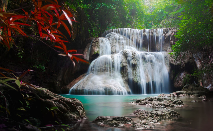 Long Exposure Water Motion Waterfall Beauty In Nature Flowing Water Scenics - Nature Tree Plant Nature Blurred Motion Rock Forest No People Land Rock - Object Solid Environment Flowing Rainforest Power In Nature Outdoors Falling Water