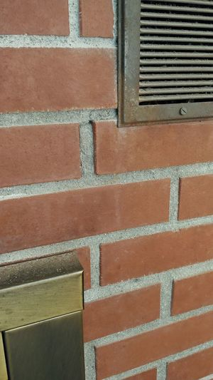 Twisted Tuesday LG V30 Rocking Red Another Brick In The Wall Full Frame Brick Wall Close-up Architecture Built Structure Brick Metal Grate