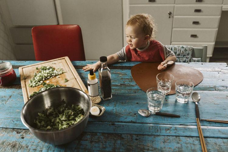 Boy having food at home