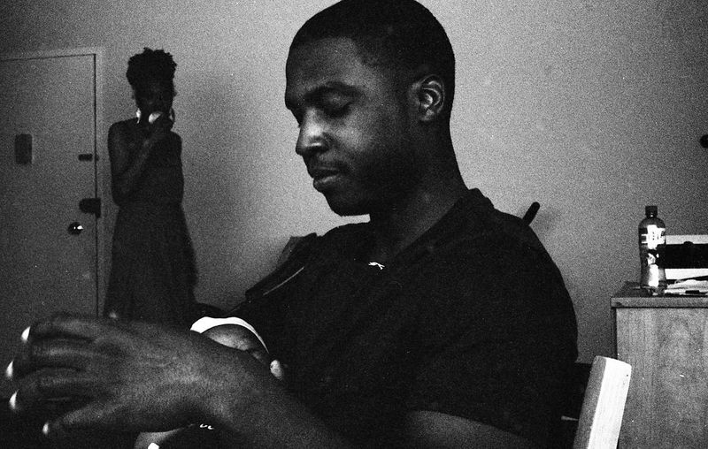 Photo by Kesi J. Marcus Adult Apartment Blackandwhite Day Daytime Father Father & Son Film Photography First Baby Indoors  Mother Newborn People Real People Sitting Two People Young Adult