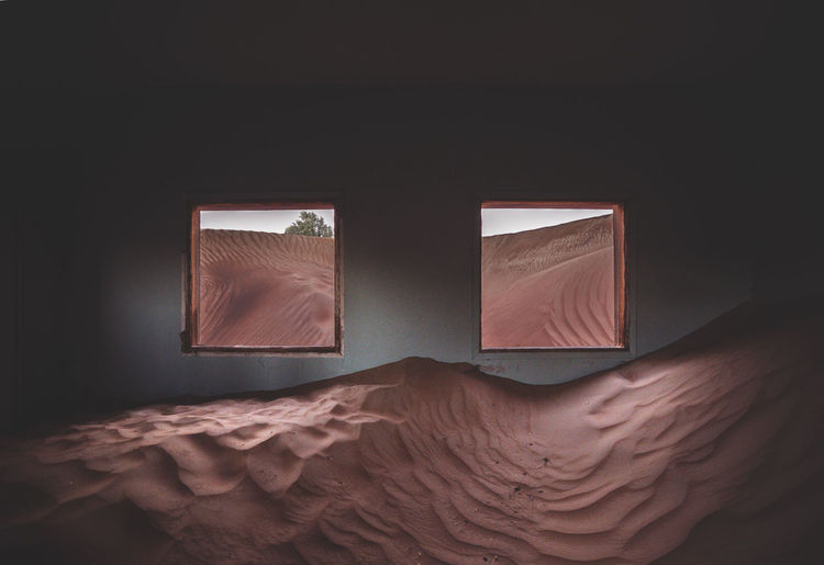 Room full of sand with windows