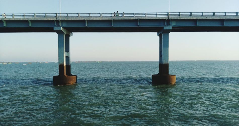 Scenic view of bridge over sea against clear sky